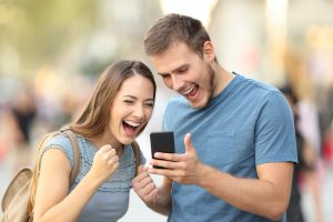 Winners Excited Couple Phone