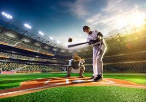 Baseball Player Hitting Ball.